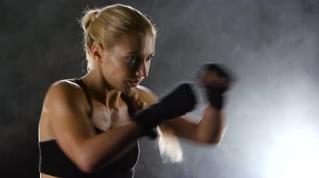 warms : Strong blows by hands with fists of boxer sporswoman