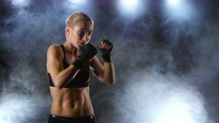 warms : Training before the fight athletic girl boxer