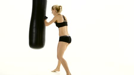 warms : Training with a punching bag at the sportswoman boxer