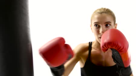 warms : Woman boxer takes out aggression on the punching bag