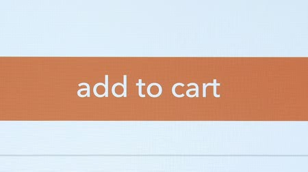 add to cart : Finger touching add to cart button on a tablet screen
