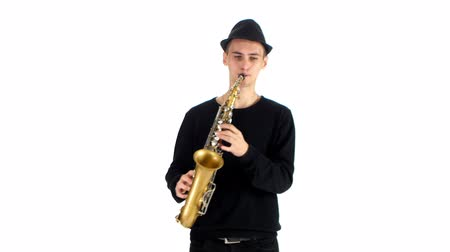 jazzman : Talented saxophonist performs solo on saxophone. White background in studio
