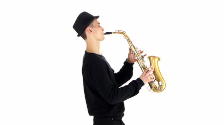 jazzman : Performs solo on saxophone talented saxophonist. White background in studio