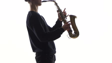 jazzman : Slow tunes on saxophone in the performance of young musician
