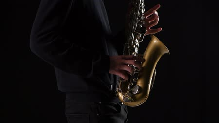 jazzman : Men hands of a professional musician playing on the saxophone