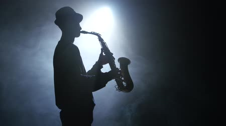 jazzman : Solo concert of the actor playing on the saxophone. Smoke