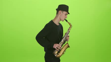 jazzman : Green screen. Saxophonist playing on the gold musical instrument