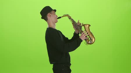 jazzman : Saxophonist playing on the gold musical instrument. Green screen Stock Footage