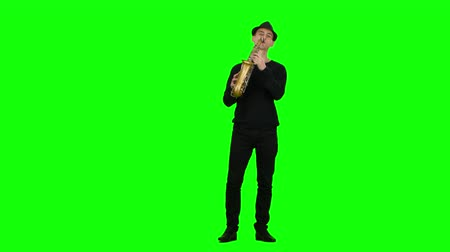 jazzman : Green screen. Jazz melodies performed by musician on the saxophone