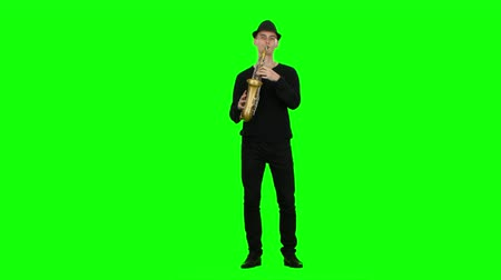 jazzman : Green screen. Blues melodies performed by musician on the saxophone
