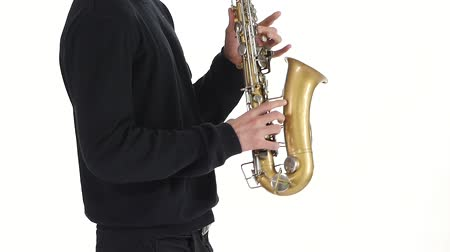 jazzman : Solo saxophone. Playing young musician man in a slow motion