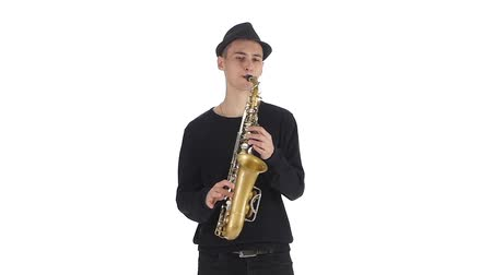 jazzman : Saxophonist in the hat plays a tune on the sax