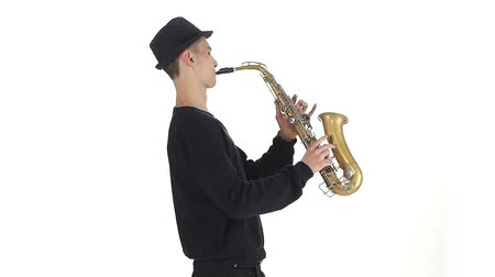 jazzman : Slow motion. Saxophonist plays a tune on the sax
