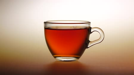 black tea : Small cup of tea with sugar. Studio Stock Footage