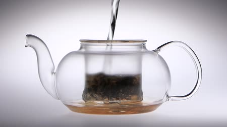 demlik : Boiling water is poured into transparent teapot with tea leaves