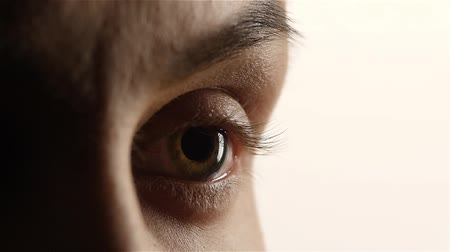 neuritis : Girl with poor eyesight wear lenses. Close up. White background. Slow motion