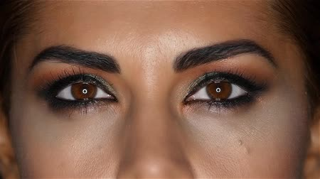 creams : Girl with make up, her face made up creams and beautiful eyes. Close up. Slow motion Stock Footage
