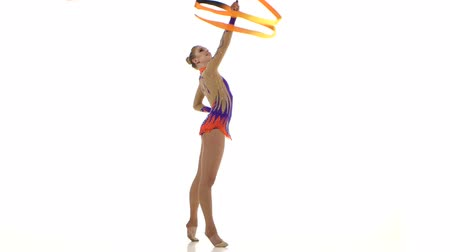 gymnasta : Flexible gymnast with tape creates beautiful hands graceful movements. White background
