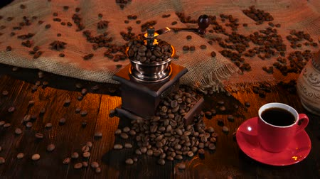 luxúria : Coffee grinder full of coffee beans and cup of espresso