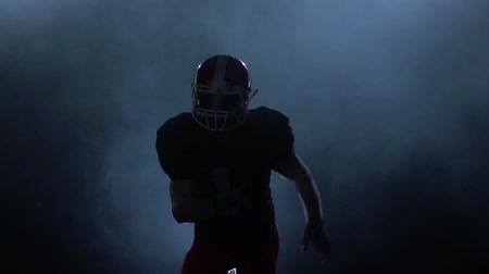lineman : Forward player in american football attack. Slow motion. Isolated studio Stock Footage