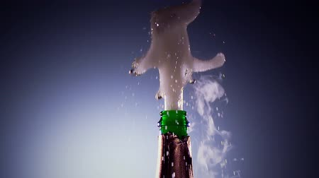 estalo : Bottle champagne wine is opened. Slow motion, lit background