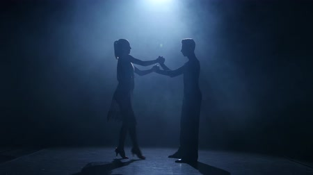 latino americana : Black background. Dance element from the rumba, silhouette couple ballroom