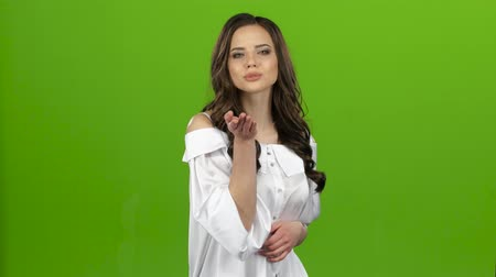 titkár : Girl flirts and sends air kisses to everyone around her. Green screen Stock mozgókép