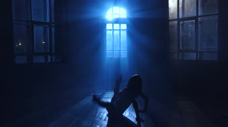fingertips : Girl teenage dances the moonlight penetrates through the window. Silhouette