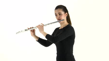 flet : Girl musician playing on flute standing sideways on white background