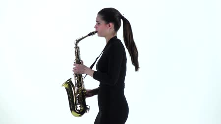 saxofone : Woman in black dress plays on saxophone melody. Slow motion Stock Footage