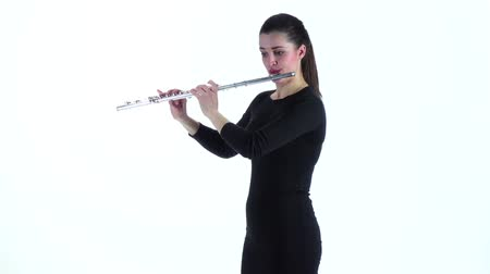 fife : Girl musician playing on flute standing sideways in slow motion Stock Footage