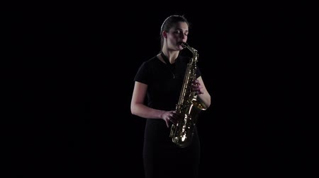 fife : Woman plays on the saxophone blues melody in slow motion