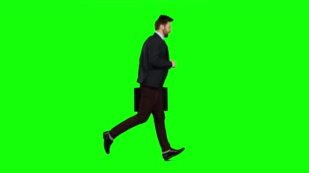 running man : Man is running a briefcase in his hand, he rushes over it. Green screen