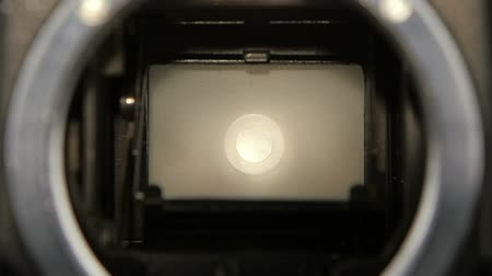fotoğraf : Camera shutter aperture transition in slow motion. Closeup camera lens
