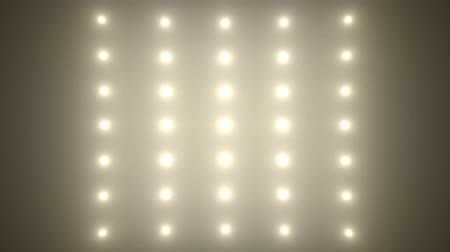 izzó : Flood lights disco background. Bright white spotlight bulbs is flashing