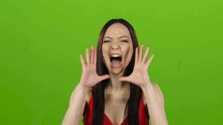 angrily : Asian girl is indignant with people, she is angry. Green screen Stock Footage