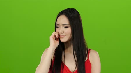 chroma key background : Girl of asian appearance yawns, her sleepy, tired. Green screen