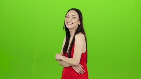 chroma key background : Asian girl is having fun and laughing loudly at her beautiful smile. Green screen. Slow motion