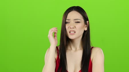 angrily : Asian girl is indignant with people, she is angry. Green screen. Slow motion