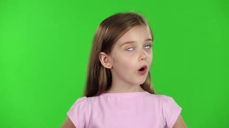 admires : Child looks with great surprise around. Green screen. Slow motion