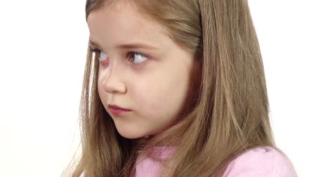 aggrieved : Child sighs heavily, she is tired. White background. Close up. Slow motion Stock Footage