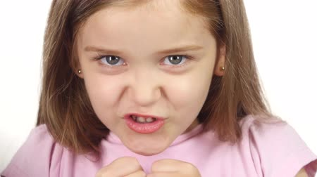 sinir : Child is angry, she is very nervous. . White background. Close up