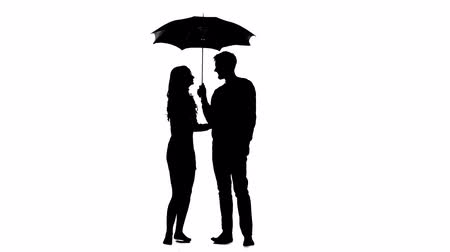 hides : Guy opens the umbrella and talks to the girl. White background. Silhouette