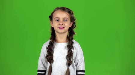 ouvido : Baby speaks into the loudspeaker. Green screen. Slow motion