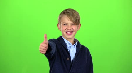 pigtailler : Baby boy shows thumbs up. Green screen. Slow motion