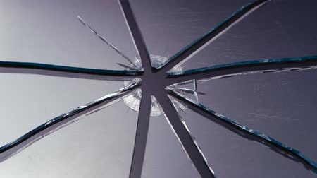 shattering : Scratched glass broken into pieces. Close up