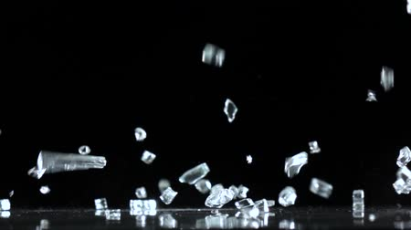 vítreo : Bright gems fall to the floor. Black background . Slow motion Vídeos