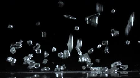 shattering : Crystals fall on a black background. Slow motion Stock Footage