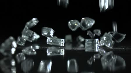 vítreo : Precious stones falling on the floor in a dark room. Black background . Slow motion