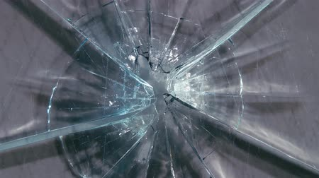 shattering : Broken glass from a bullet shot. Close up Stock Footage